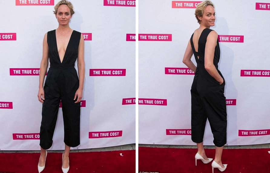 Model-and-Actress-Amber-Valletta-wearing-the-Spring-Summer-2015-jumpsuit-at-'The-True-Cost'-premiere.-Los-Angeles,-29th-May-2015_cop